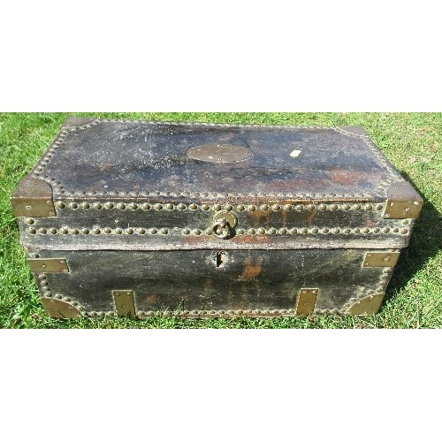 10 - A leather covered trunk having brass corners, studs and handles, the plaque engraved, Lieutenant Jos...