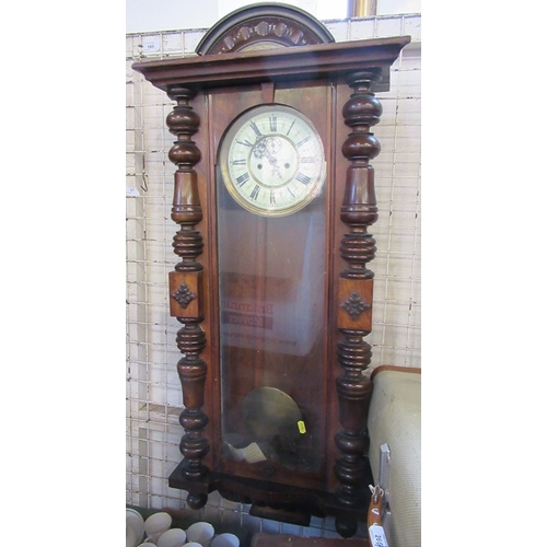 13 - A walnut cased wall clock, with Roman numerals, the case with glazed door and turned half columns, h...