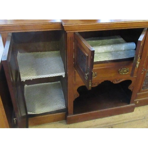 22 - An Edwardian mahogany break front side board, fitted with a cupboard, over a drawer, over a shelf, f...