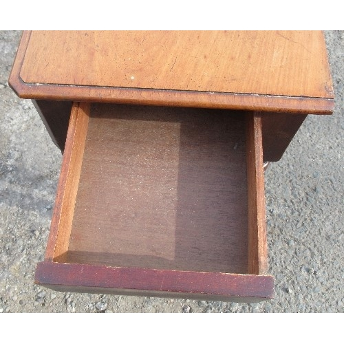 26 - A 19th century mahogany side table, fitted with an end drawer, having a shaped frieze and raised on ...