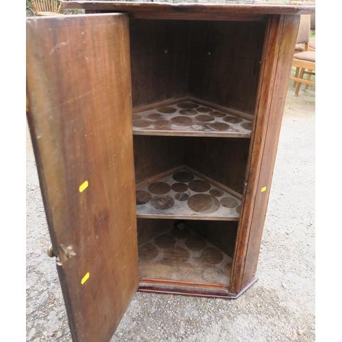 29 - A primitive country corner cupboard, diameter 20ins