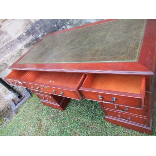 3 - A reproduction pedestal desk, having leather writing surface, and drawers around the knee hole, 54in...