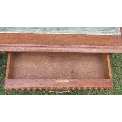 30 - A mahogany low coffee table, with leather inset top, the carved frieze with drawers raised on carved...