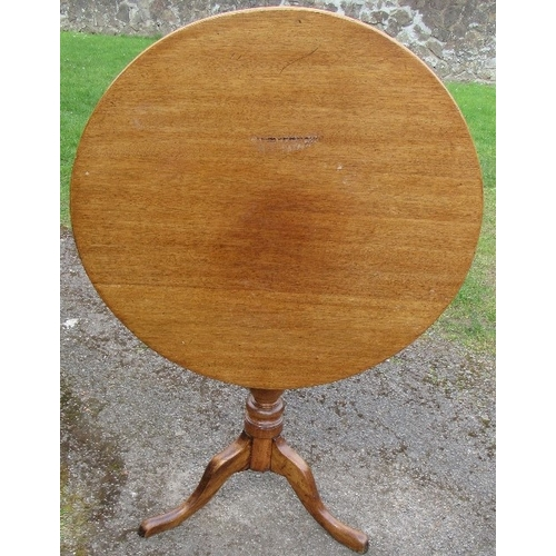 32 - An antique mahogany circular tilt top table, raised on a turned column to a triform base, diameter 2...