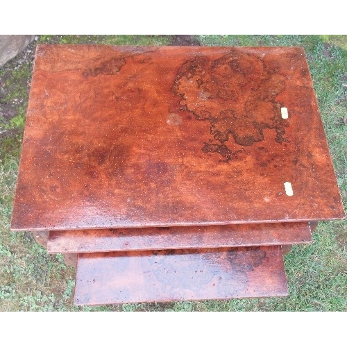 35 - A next of three burr wood coffee tables, 22ins x 15ins and down