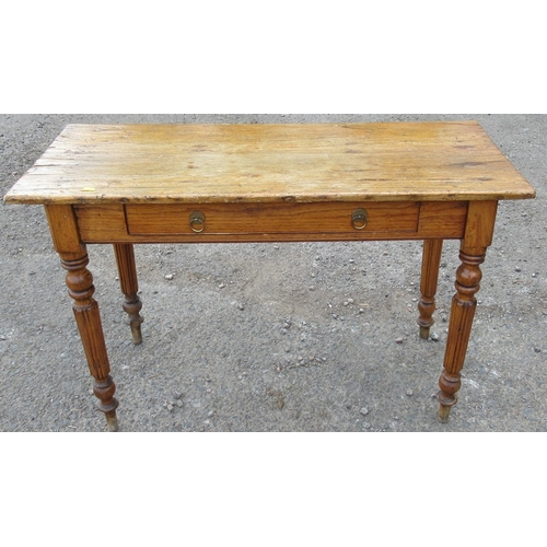 36 - An antique pine side table, fitted with a frieze drawer and raised on turned legs, 43ins x 17.5ins x...