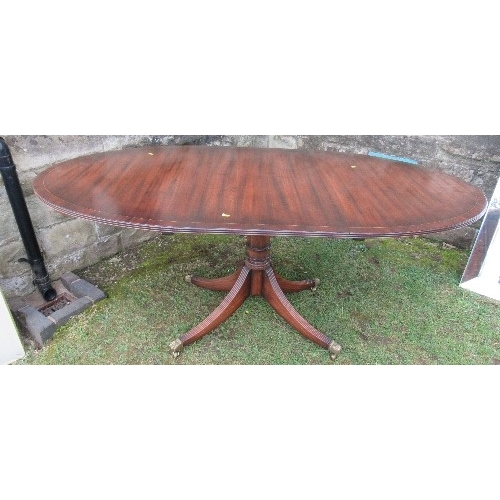 37 - A mahogany tripod dining table, raised on a column with four reeded legs, length closed 54ins, toget...