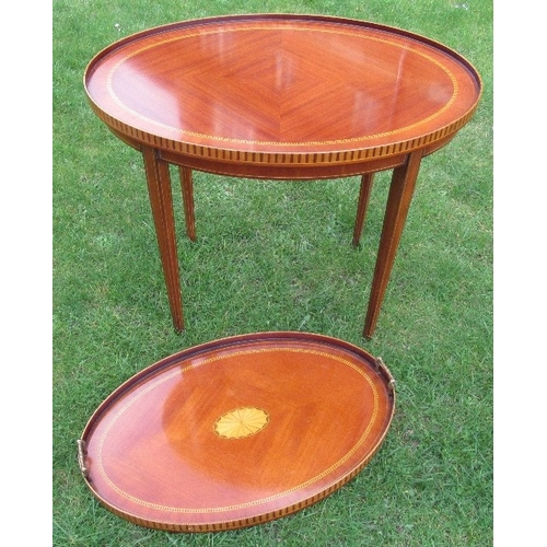 39 - A mahogany and satinwood inlay oval table, the top with galleried sides, raised on square tapering l...