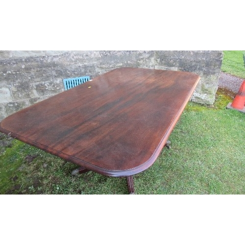 4 - A 19th century mahogany tilt top breakfast table, the rectangular top raised on a turned column and ...
