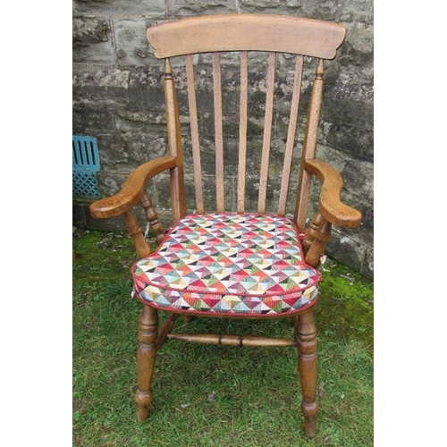 40 - A Windsor style open armchair, with stick back, having turned supports to the shaped arms
