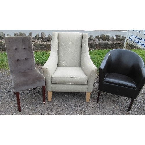 41 - A modern upholstered armchair, with fire labels, together with two other modern upholstered chairs, ...