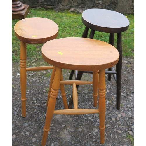 46 - Three oval topped stools, height 21.5ins and 24ins