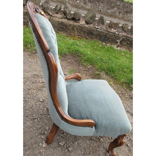 48 - A Victorian show wood nursing chair, with carved and button spoon back, raised on short cabriole leg...