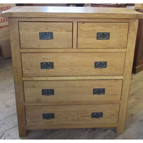 8 - A modern oak chest, of two short over three long drawers, 39ins x 16.5ins x height 43ins