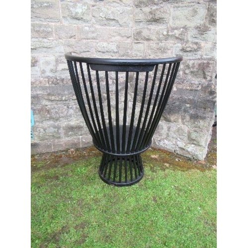 14 - Ebonised high comb back chair of inverted pyramid form.