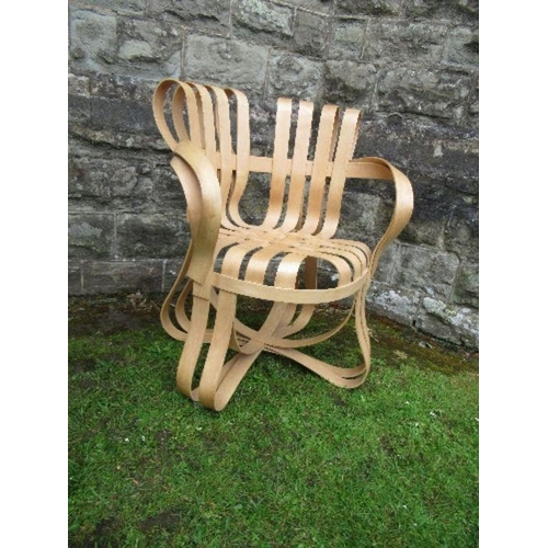 15 - An armchair of cross check in bent and laminated wood after Frank Gehry