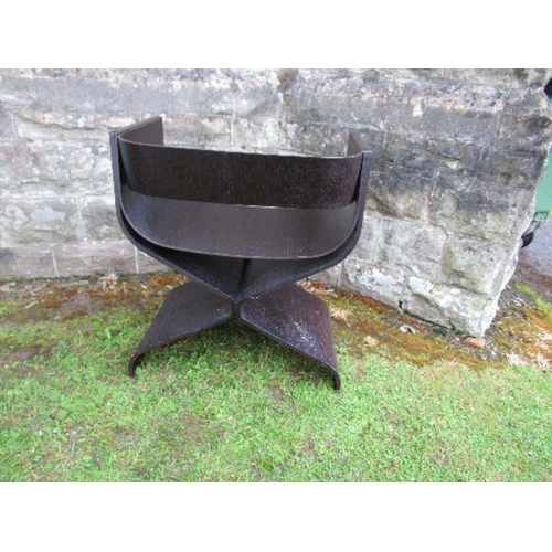 16 - An ebonised chair, of curved cross frame form
