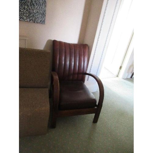 19 - An Art Deco leather open armchair