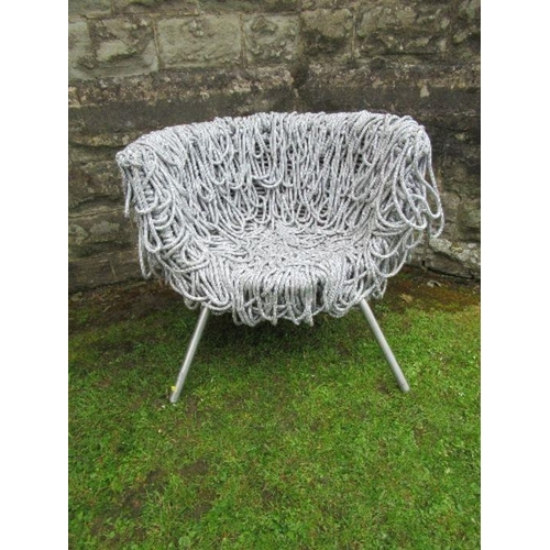 2 - A draped silver rope designer armchair