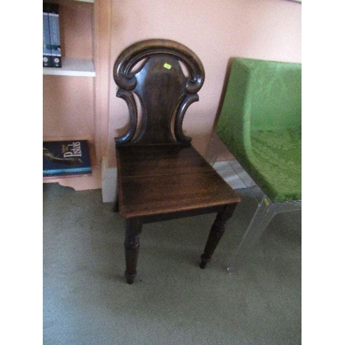 24 - Two pairs of armorial hall chairs , in oak