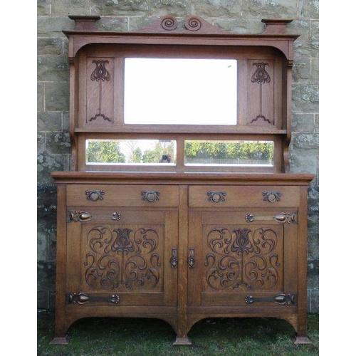 27 - A Liberty style oak Art Nouveau mirror back sideboard, with copper mounts, width 59.5ins, depth 23in...