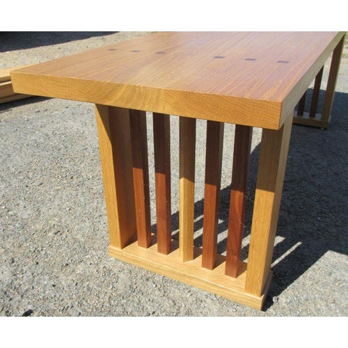 29 - An oak and black walnut bench, with label to the base, Jeremy Cornwell, width 59ins x height 18.5ins...