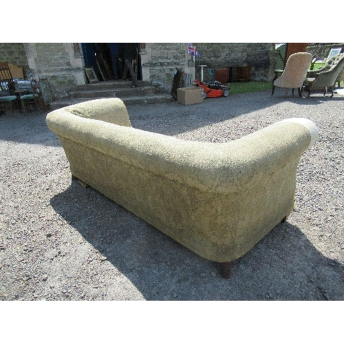 38 - A Chesterfield sofa, with roll ends and raised on short inverted legs, no cushions, width 88ins x gr...