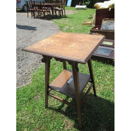 39 - An Arts and Crafts style square topped side table, raised on outswept legs united by a shelf, bearin...