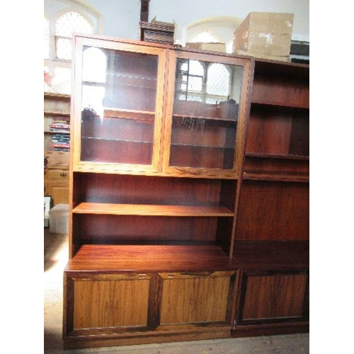 40 - A teak, oak and rosewood bookcase unit, in the Danish style, manufactured by Sejling Skabe, Silkebor...