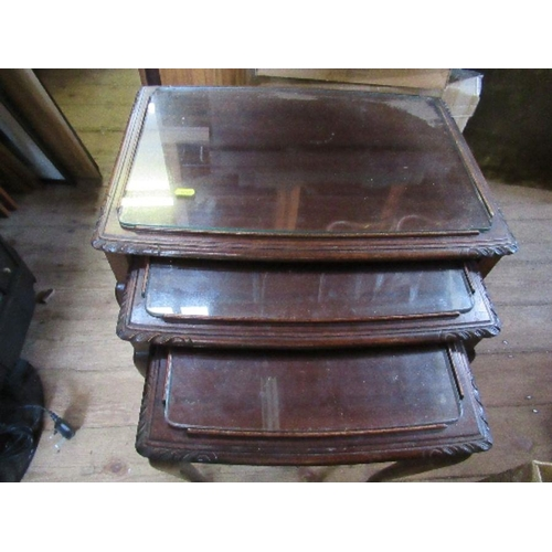 47 - A nest of three oak tables, with glass tops, width 22ins and down