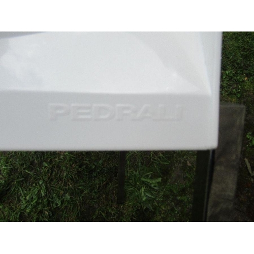 5 - A white Pedrali chair raised on four metal legs
