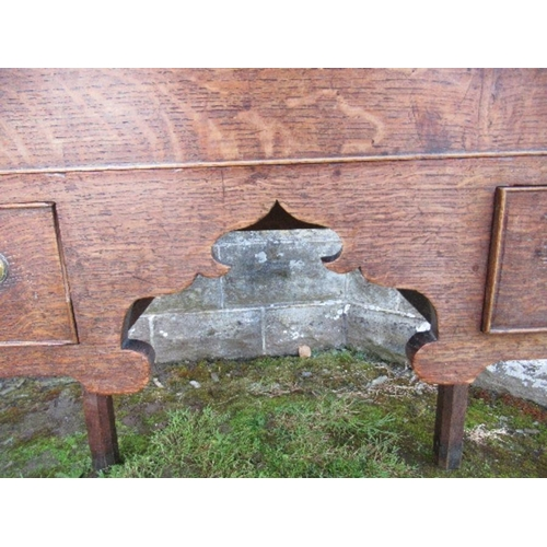 52 - An 18th century oak low boy, fitted with one long drawer and two short drawers within a shaped friez...