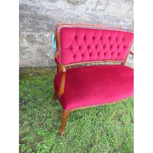 58 - A modern upholstered and show wood settee, with button back and carved decoration, with Fire Labels