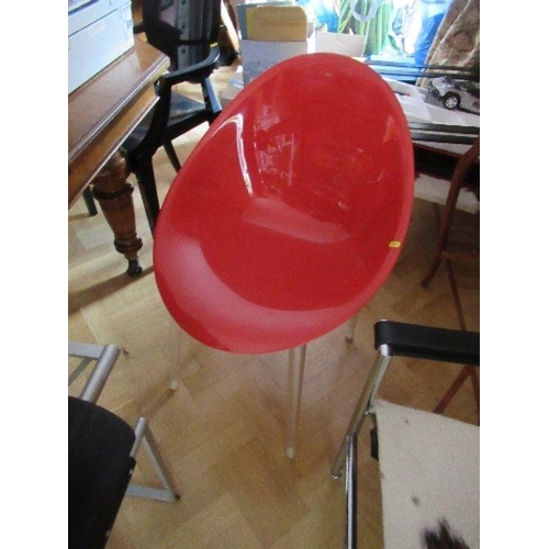 7 - Red plastic and Perspex chair raised on metal legs