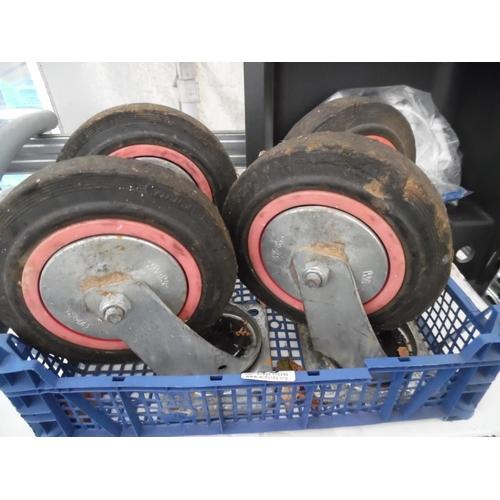 49 - Set 4 industrial trolley wheels...