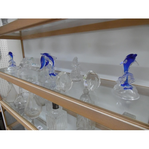 53 - Shelf of assorted crystal dolphins...