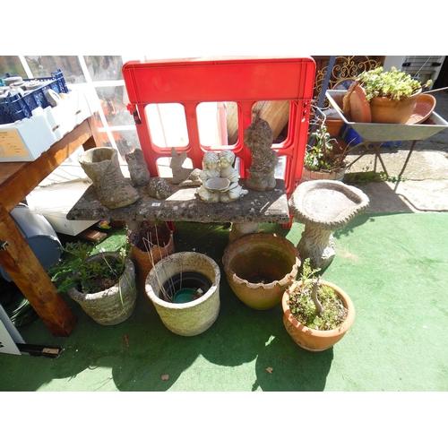44 - Stone garden bench, terracotta pots etc...