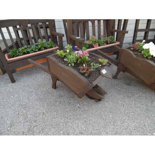 53 - Planted wheelbarrow planter...