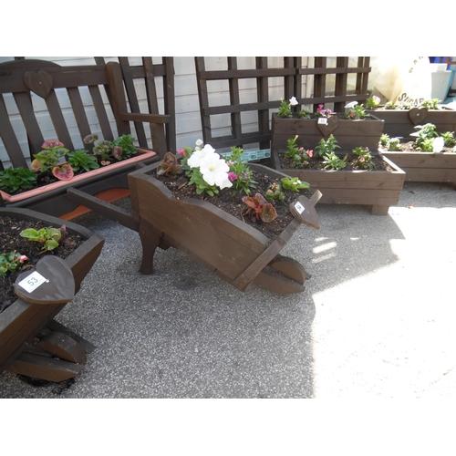 54 - Planted wheelbarrow planter...