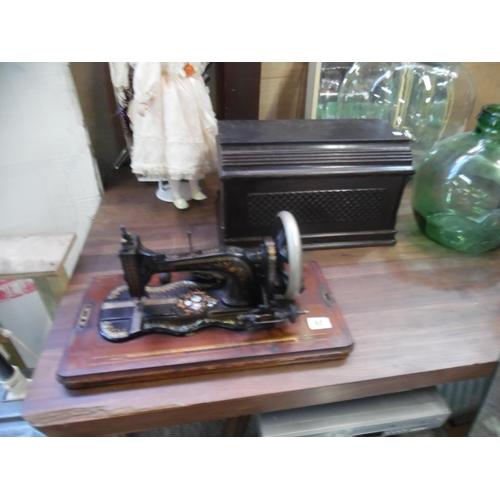 60 - Singer sewing machine...