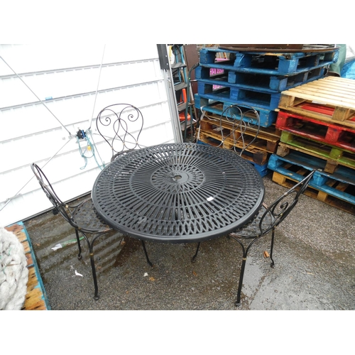 4 - Cast garden table & 4 chairs...