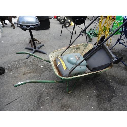 4 - Wheelbarrow & electronic lawn rake...