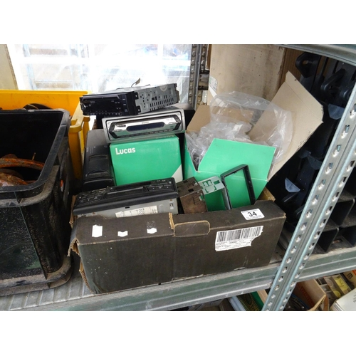 34 - Box of car radios...