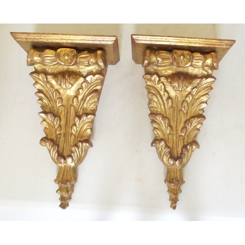 16 - A Pair of Italian Giltwood Wall Brackets Carved Acanthus Leaf Designs. Early 1900s. Height 31.5 cm. ...