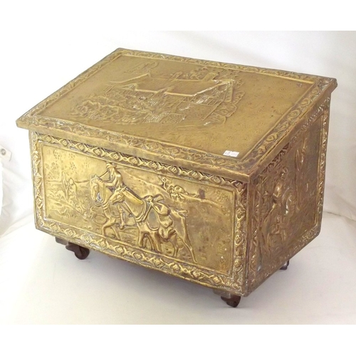 20 - Antique Brass Repousse Coal Box with Sloping Hinged Lid on Casters.Early 1900s. Height 34 cm. 46 x 3...