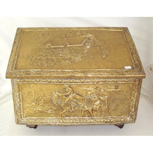 6 - Antique Brass Repousse Coal Box with Sloping Hinged Lid on Casters.Early 1900s. Height 34 cm. 46 x 3...