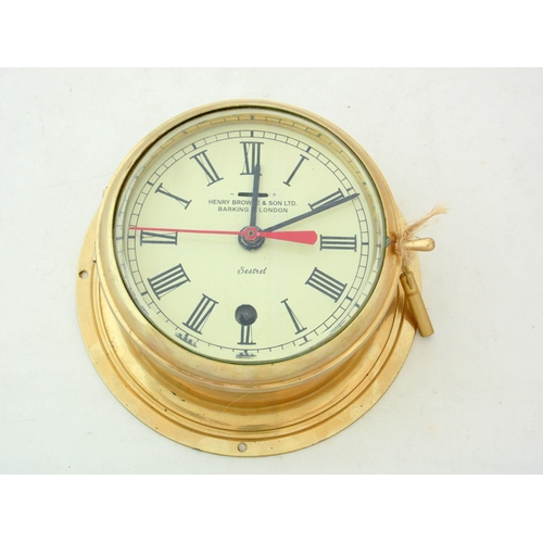 11 - Sestrel HENRY BROWNE & SON LTD BARKING & LONDON Brass Bulkhead Clock.  Height 8 in. Diameter Dial 5 ...