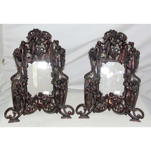 2 - A Pair of Edwardian English Patinated Cast Iron Picture Frames Decorated with Classical Figures. Ear...