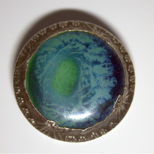 33 - Arts And Crafts Ruskin Style Circular Brooch, Blues & Greens With Silver Edging, Unmarked, 40mm Diam...