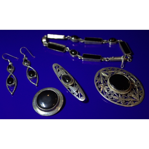 51 - Collection Of Silver And Black Stone Jewellery Comprising A Bracelet, 3 Brooches And A Pair Of Twist...
